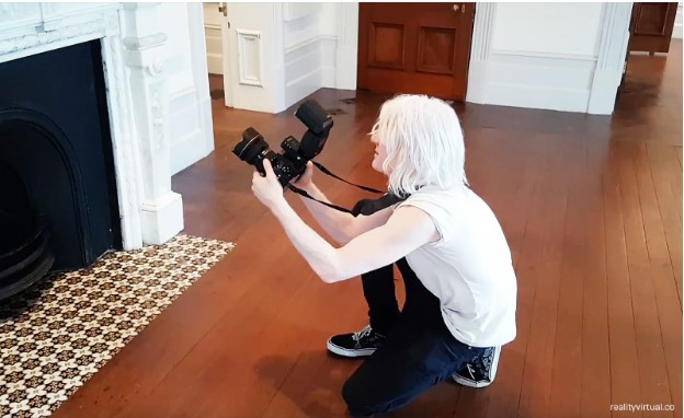 Simon Che de Boer takes high-resolution photos at the Sir James Wallace Homestead.