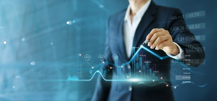 Businessman draw growth graph and progress of business and analyzing financial and investment data ,business planning and strategy on blue background.